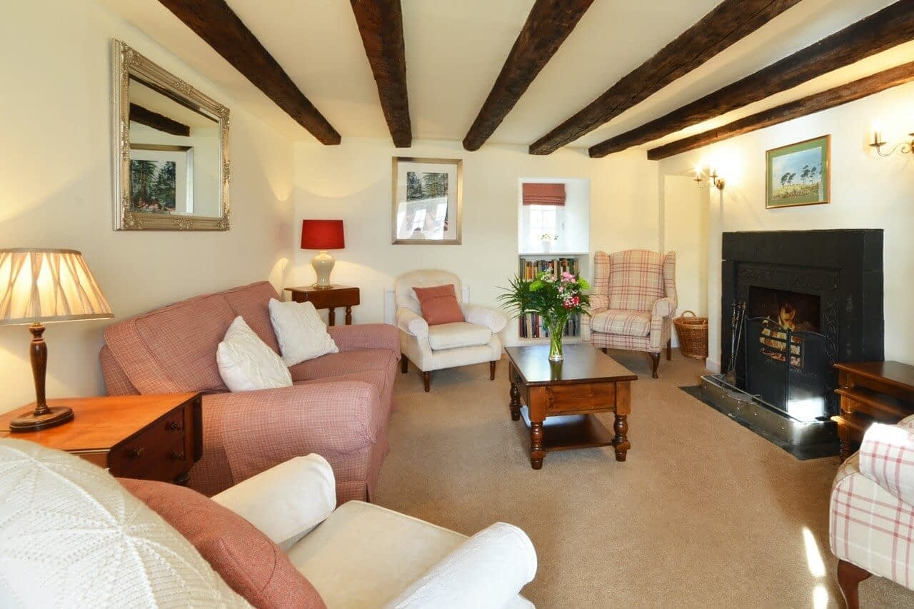 Sitting room with fire The Old Granary - Dunrobin Holiday Cottages, Caithness