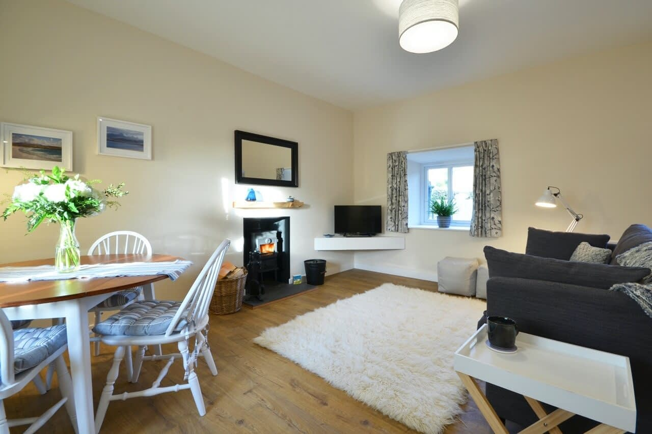Open-plan living space at Bluebell Cottage - Dunrobin Holiday Cottages, Caithness