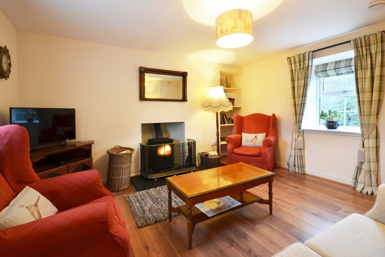 Sitting room with wood burner Keepers Cottage - Dunrobin Holiday Cottages, Caithness
