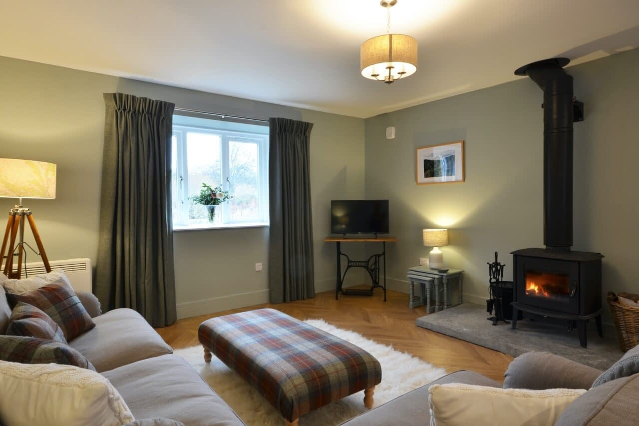 Open plan living room at Porter's Lodge - Dunrobin Holiday Cottages, Caithness