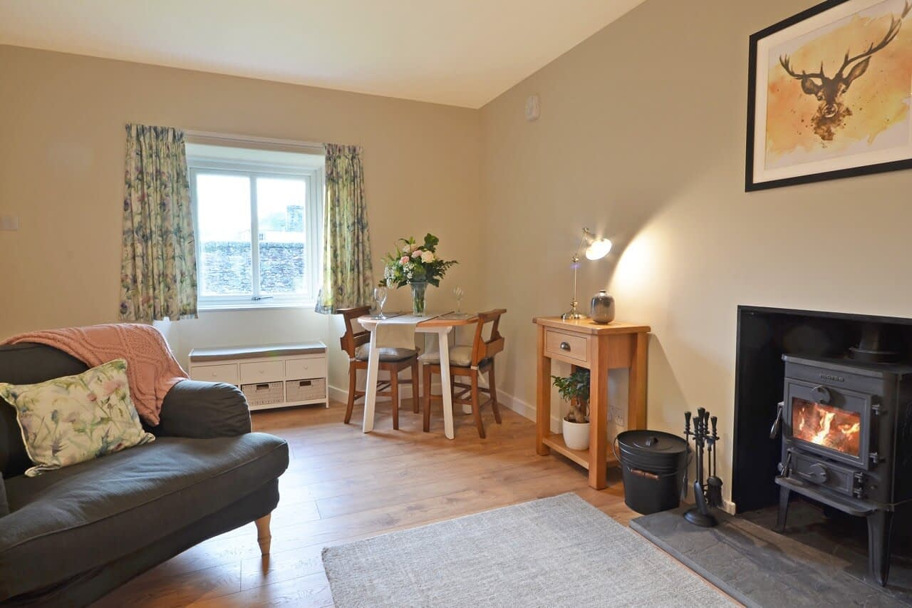 Living room with stove Snowdrop Cottage - Dunrobin Holiday Cottages, Caithness
