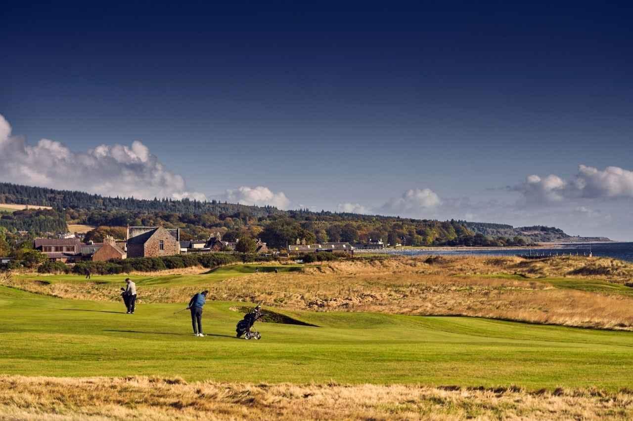 golfers take a shot on golspie golf course